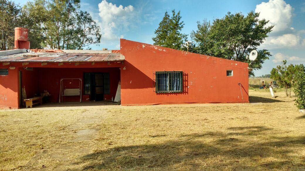 ———RESERVADO—-Quinta a metros de Ruta 30 en Roque Perez, zona rural, dos casas, boxes caballos, muy buenos alambres